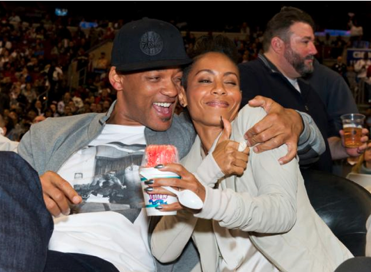 Will Smith and Jada Pinkett Smith enjoying themselves at a 76ers game.