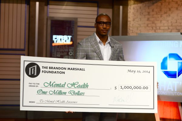 Bristol, CT - May 20, 2014 - Studio B: Brandon Marshall on the set of First Take with a $1 million donation check for mental health (Photo by Joe Faraoni / ESPN Images)