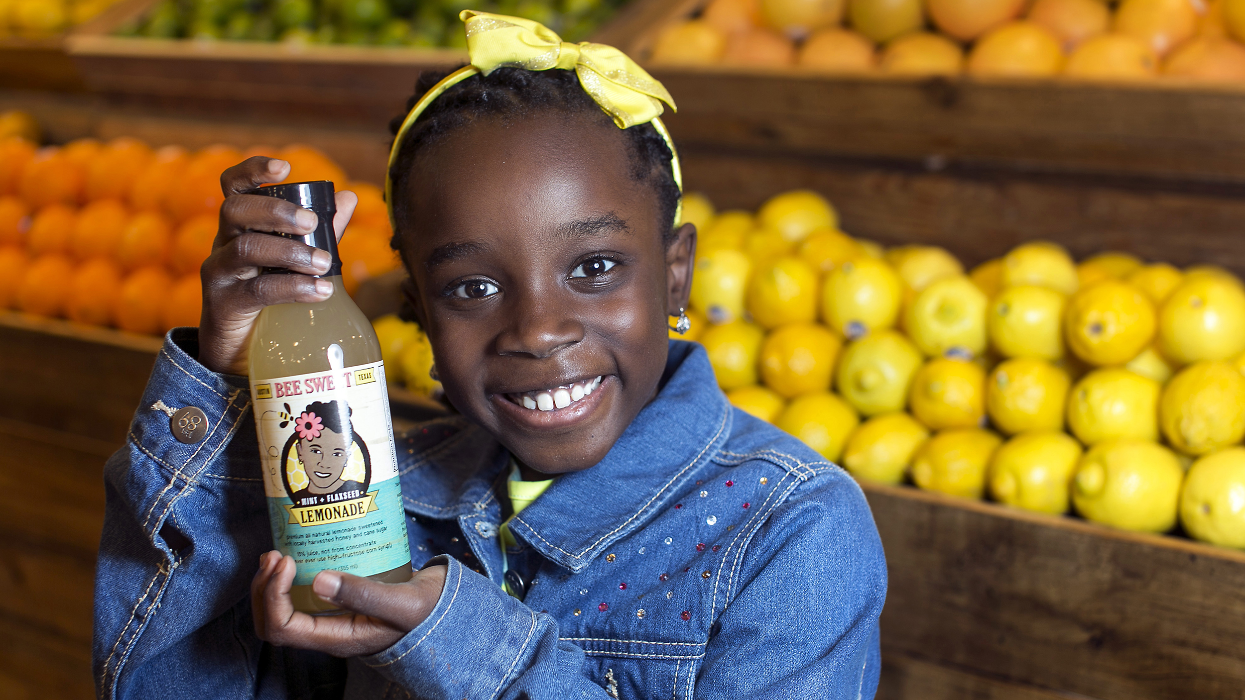 ADVANCE FOR RELEASE MONDAY, FEB. 24, 2014, AND THEREAFTER - In this Jan. 27, 2014 photo Mikaila Ulmer stands for a photo as she holds a bottle of Bee Sweet Lemonade that she and her family make and sell at Whole Foods at the Domain in Austin, Texas. The drink contains locally harvested honey and 20 percent of the proceeds go to organizations that help save honeybees. (AP Photo/Austin American-Statesman, Rodolfo Gonzalez) AUSTIN CHRONICLE OUT, COMMUNITY IMPACT OUT, INTERNET MUST CREDIT PHOTOGRAPHER AND STATESMAN.COM